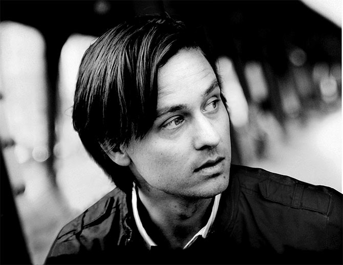 Tom Schilling as Nico Fischer in A Coffee in Berlin