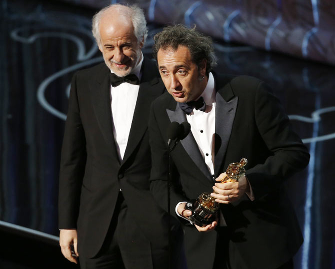 Paulo Sorrentino delivres his acceptance speech as actor Tony Servillo looks on