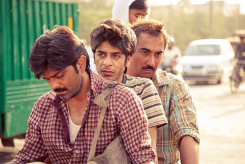 Shashank Arora, center, and Ranvir Shorey, right, in a scene from Titli.