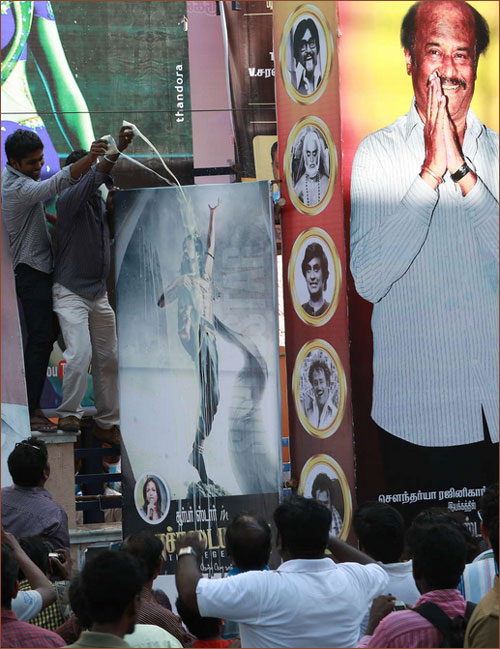 Fans pour milk on the Kochadaiiyaan poster