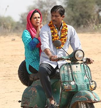 Mona Singh and Adil Hussain in Zed Plus