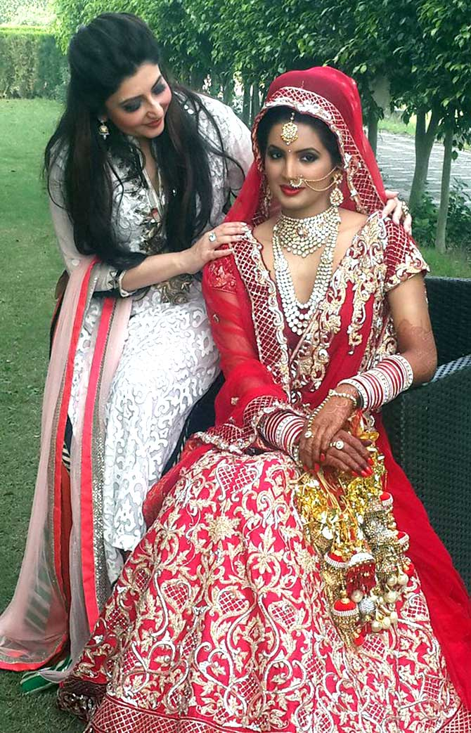Harbhajan Singh's bride Geeta Basra poses in all her wedding splendour on Thursday