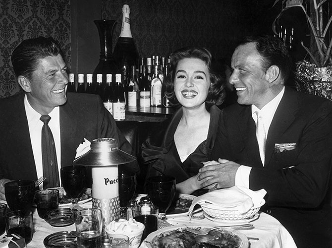 Ronald Reagan, Barbara Rush and Frank Sinatra celebrate the premiere of the latter's film, A Hole In The Head