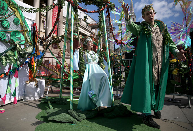 Actors perform Shakespeare's A Midsummer Night's Dream during an event to celebrate St George's Day in London.