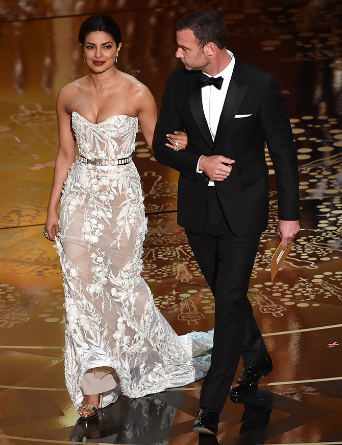Priyanka Chopra with Liev Schreiber at the Oscars. Photograph: Kevin Winter/Getty Images