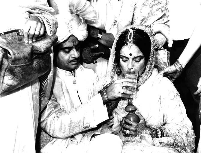 The newly weds: Poonam Sinha breaks her fast with a sip of water given by her husband, Shatrughan