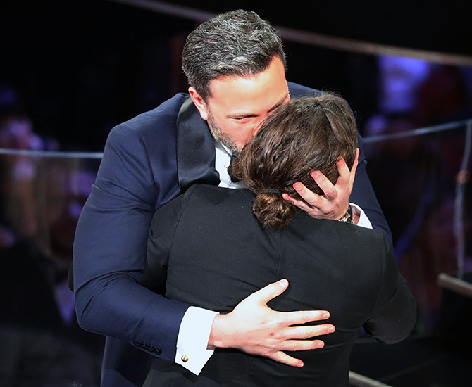 Ben Affleck kisses his younger brother after Casey Affleck  won the Best Actor Oscar.