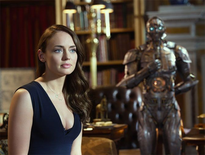Laura Haddock as Viven Wembley and Cogman in the background