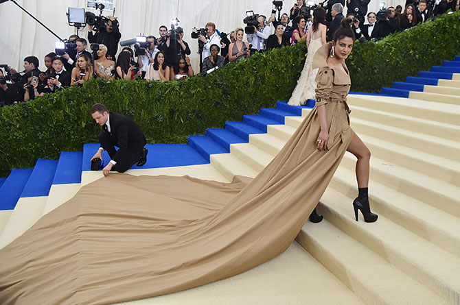Priyanka's famous double breasted trenchcoat with a dramatic train at the Met Gala last year