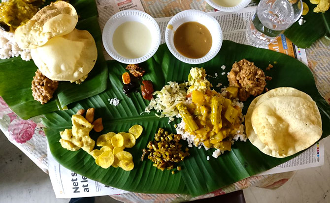 Pics: The great Onam Sadhya and a lovely pookalam