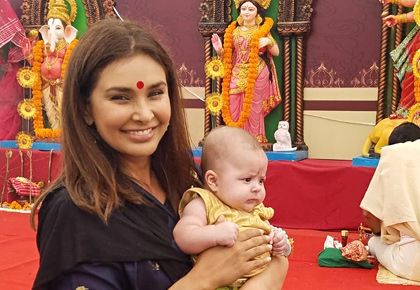 How cute! Lisa Ray at Durga Puja with her twins
