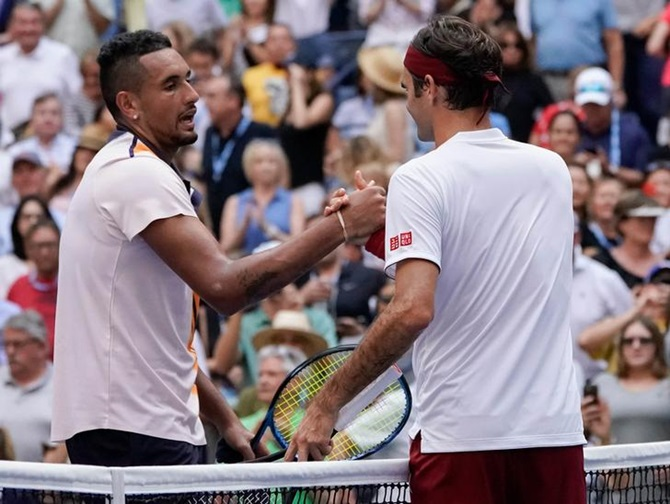 Nick Kyrgios congratulates Roger Federer after the match