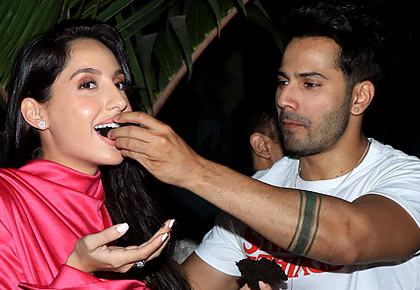 Current Bollywood News & Movies - Indian Movie Reviews, Hindi Music & Gossip - PIX: Varun, Elli celebrate Nora's birthday