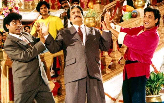 Kader Khan, centre, flanked by Govinda and Johnny Lever, left.