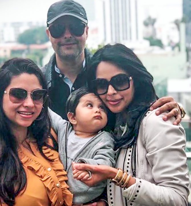 Mallika with her adorable nephew and his parents. Photograph: Kind courtesy Mallika Sherawat/Instagram