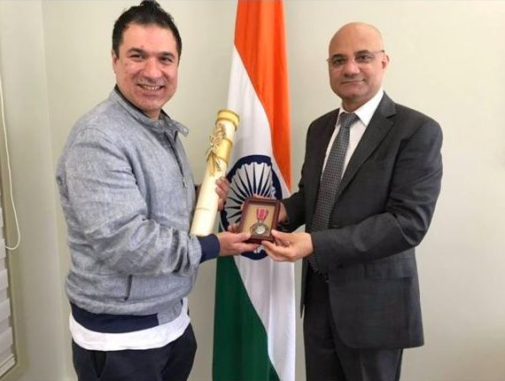 Sarfaraz Khan receives the Padma Shri from Dinesh Bhatia, India's consul general in Toronto, right.