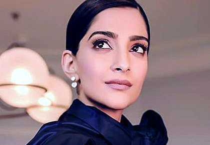Pix: Sonam flirts with purple and red at Cannes!