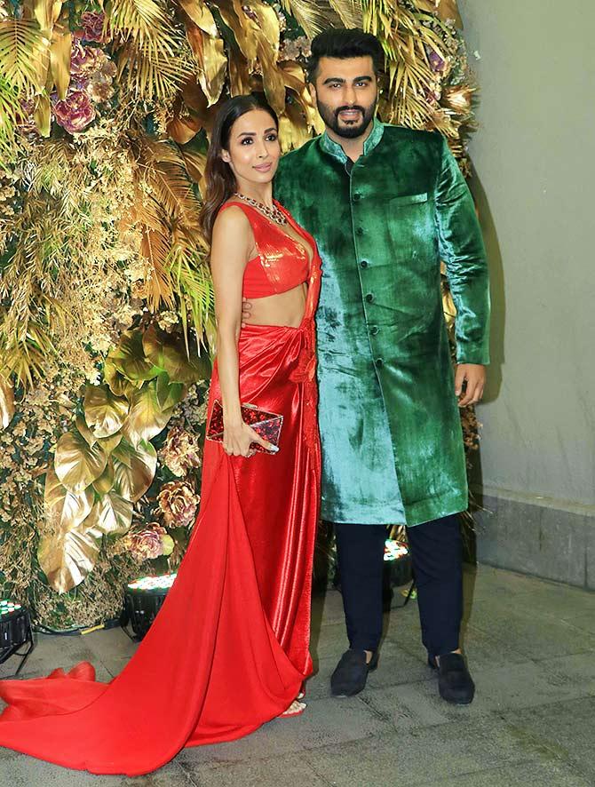 Video: Malaika-Arjun get spotted at a wedding - Rediff.com movies