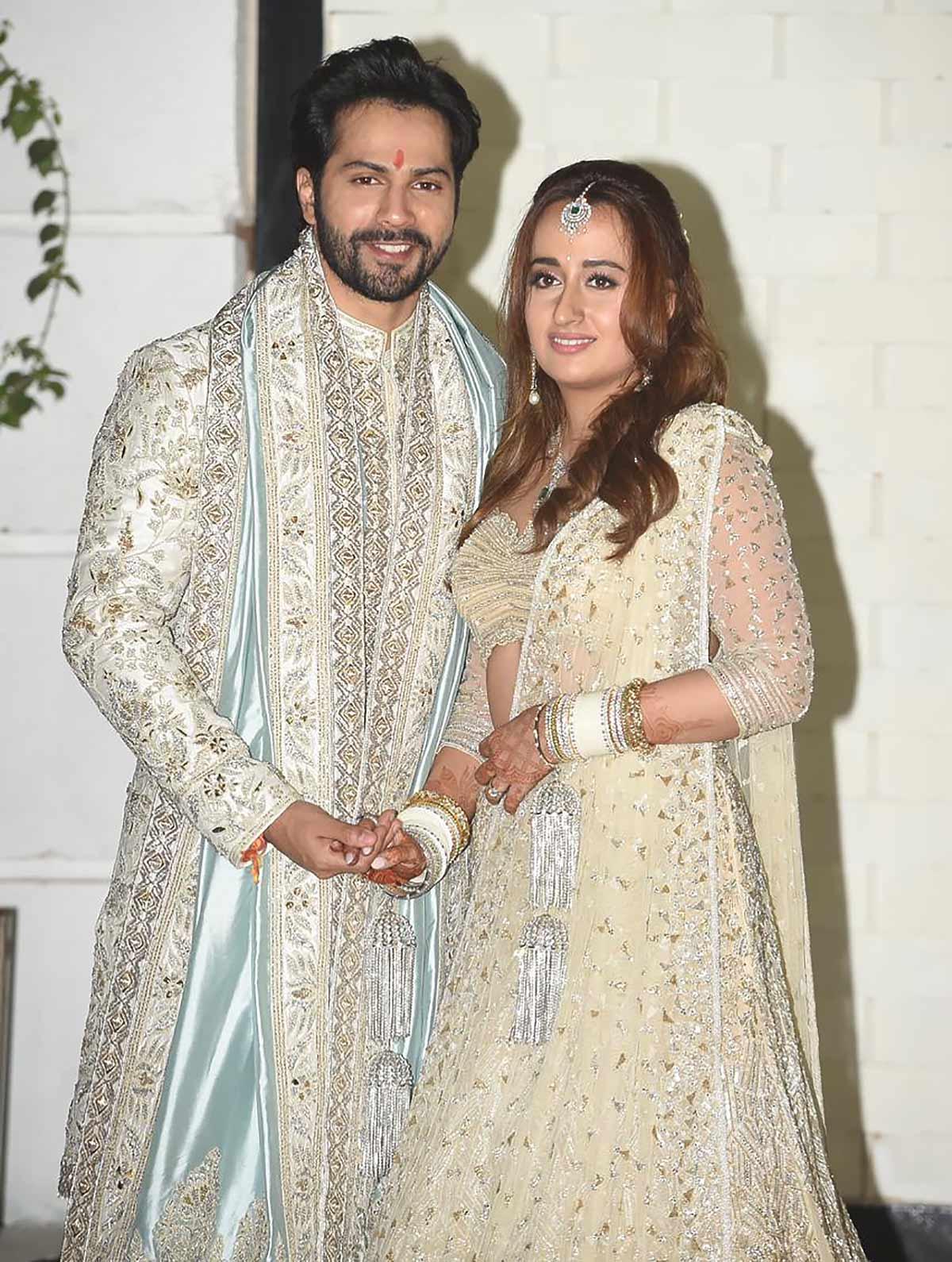 Who designed Varun's wedding look?