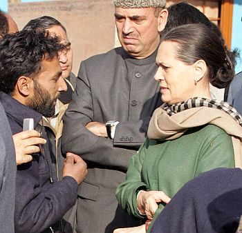 Congress president Sonia Gandhi listens to a Kashmiri as Azad watches