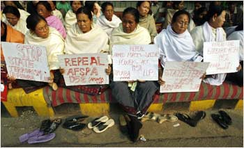Women hold placards during a protest against the Armed Forces Special Powers Act  in New Delhi