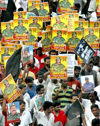 Protesters hold portraits of slain LTTE leader Prabhakaran during a rally against Sri Lanka's President Mahinda Rajapaksa in Chennai.