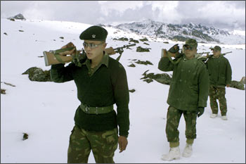 Indian soldiers patrol near the border with China in Tawang
