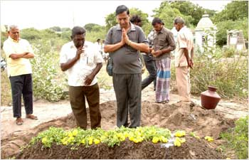 Sreedhar, giving a burial to 17 unclaimed bodies