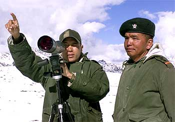 An Indian soldier points towards the border with China in Tawang, Arunachal Pradesh.