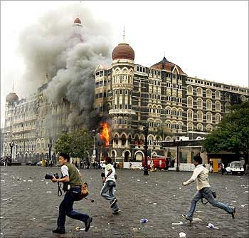 The media flees gunshots fired by terrorists inside the Taj.