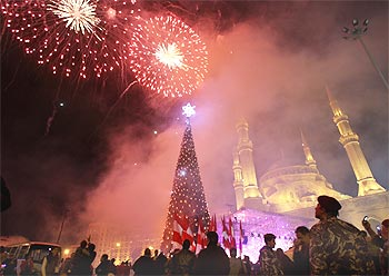 Fireworks explode as a giant Christmas tree is illuminated at a Christmas parade in downtown Beirut