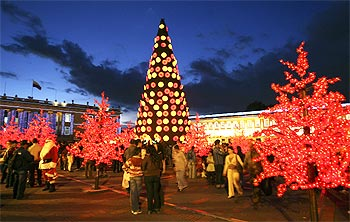 People gather at Bogota's illuminated central square ahead of Christmas