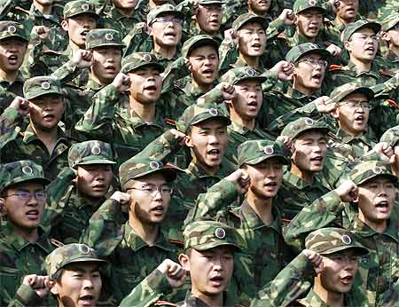 Graduates of the People's Liberation Army take an oath in Jinan in Shandong province