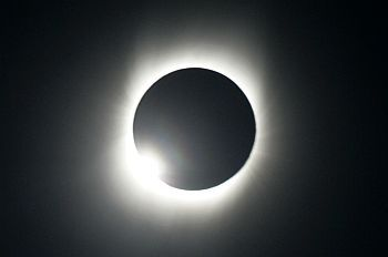 The moon passes between the sun and the earth during a total solar eclipse in Varanasi, Uttar Pradesh