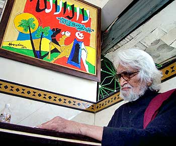 A photograph of painter M F Husain at a restaurant in Ahmedabad