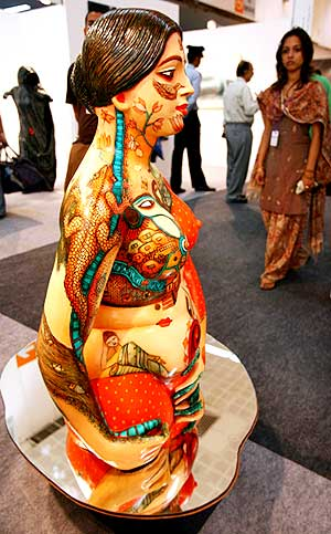A visitor looks at contemporary art during the India Art Summit in New Delhi, August 23, 2008.