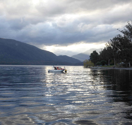 Rain clouds gather over Lake Te Anau on the south island of New Zealand