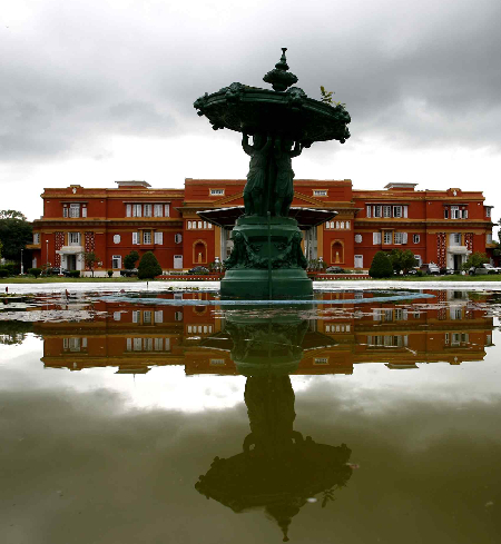 The Shital Niwas Palace or the presidential palace is reflected on a pond in Kathmandu