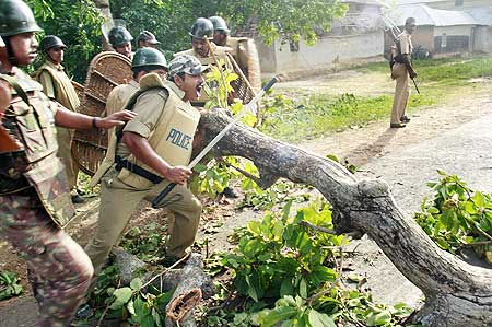 Police remove a roadblock set by the activists of People's Committee Against Police Atrocities at Bhimpur near Lalgarh