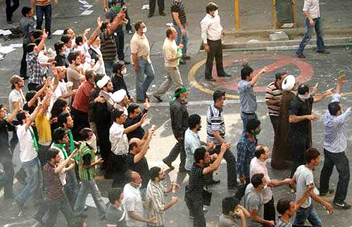 Protesters gesture on a street in Tehran in this undated photo uploaded onto Twitter