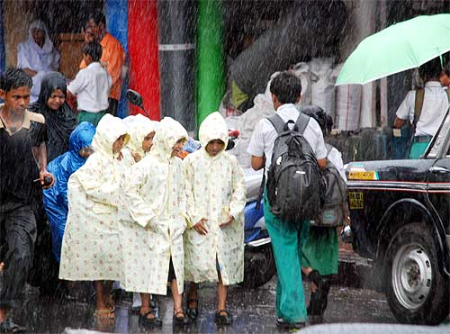 Shool children walking home in the rain