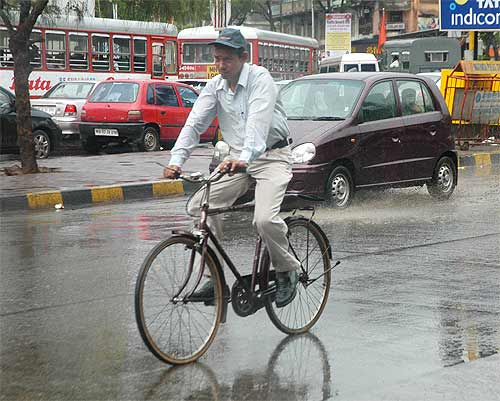 A cyclist caught in the monsoon shower
