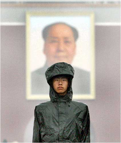 A paramilitary policeman stands guard in Tiananmen Square in Beijing