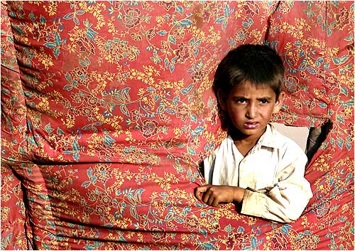 An internally displaced boy, who fled a military offensive in Swat, at a UNHCR tent