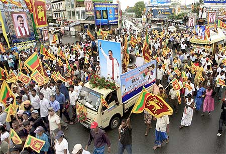 Thousands of people participate in a street parade in central Colombo May 22 to celebrate the defeat of the LTTE