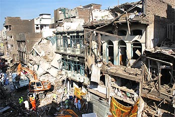 These damaged buildings in Peshawar are a grim reminder of the deadly blast in a crowded market that killed 105 people on October 28.