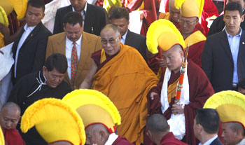 Dalai Lama waves to the crowd at Tawang