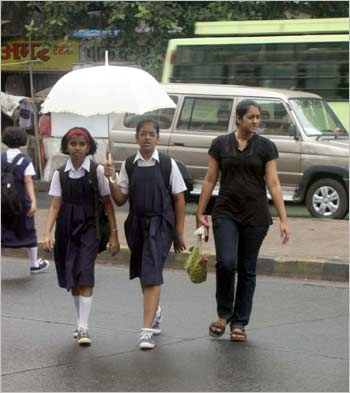 School kids in Mumbai braving the heavy rains.
