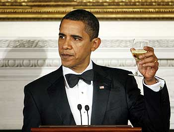 US President Barack Obama raises his glass for a toast while hosting the Governors dinner at the White House
