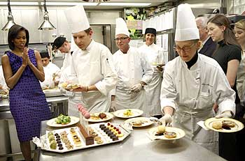 Chefs bring out dishes for the Governors dinner at the White House